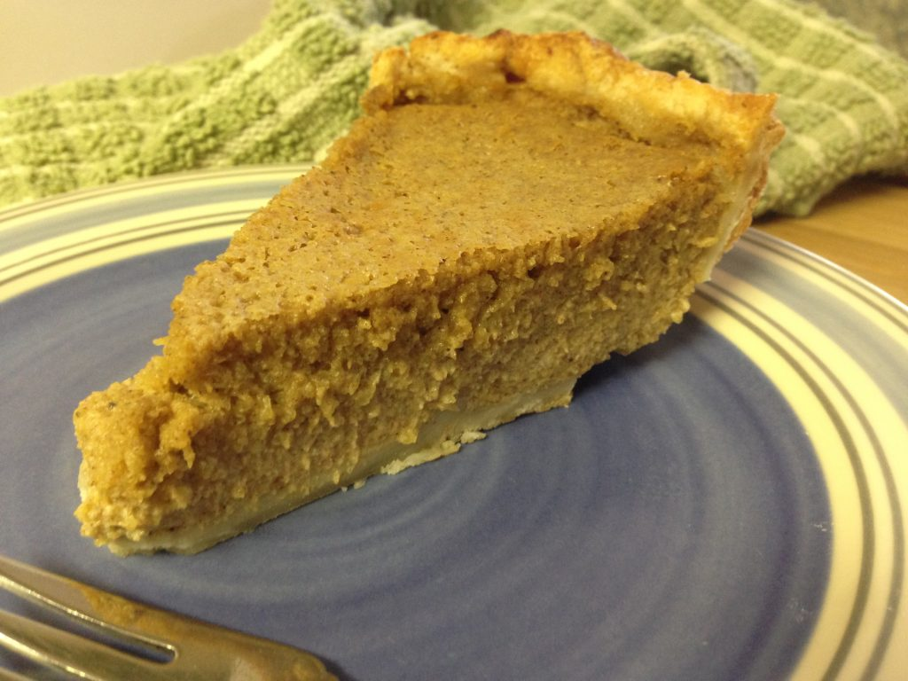 a slice of pumpkin pie sits on a plate