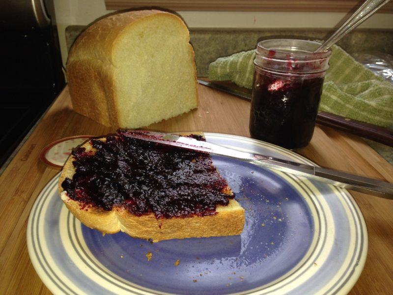 a slice of fresh homemade bread with homemade jam