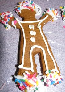 decorated gingerbread boy sits on a counter