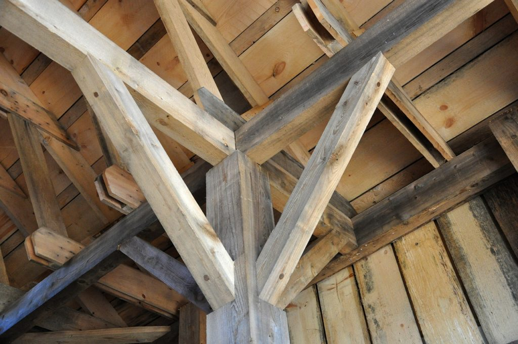 milled wood forms the interior ceiling in a post and beam house