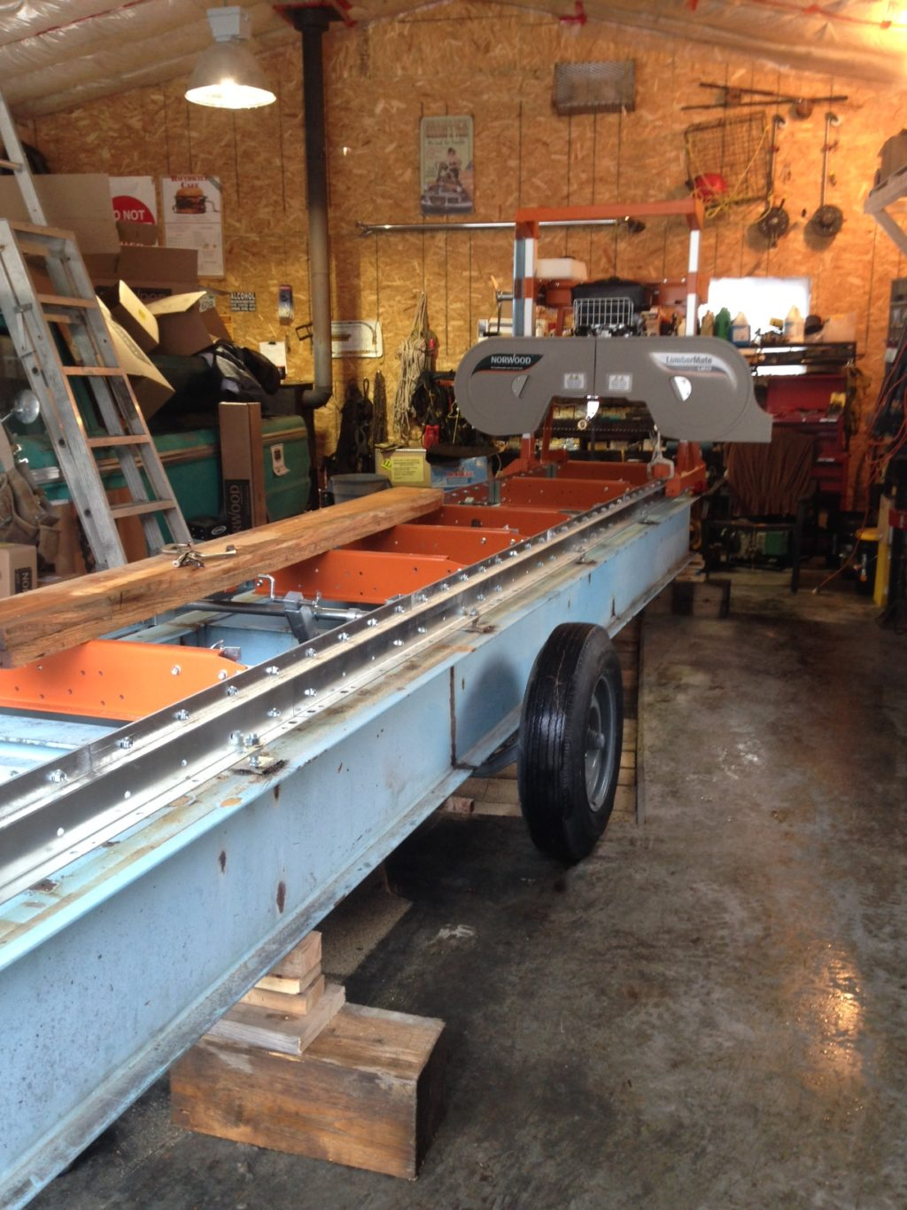 Sawmill assembled on frame and trailer