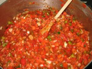 salsa simmering in a pot on the stove