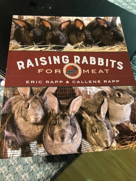 a copy of the book Raising Rabbit for Meat