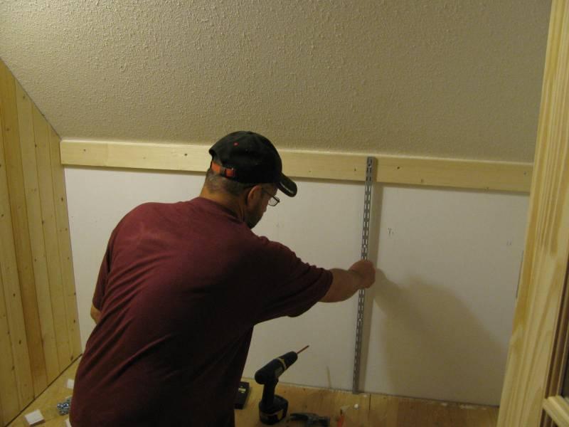 a man building a closet